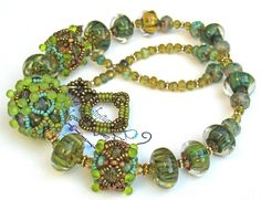 Reserved Harvest Jewels Beaded Bead and Borosilicate Glass Necklace -- Leaves. $249.00, via Etsy.