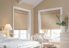 Provenance® Woven Wood Shades by Hunter Douglas bring the warmth of nature into this beach style bedroom.