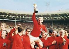 England captain, Bobby Moore, holding the Jules Rimet Trophy after England's World Cup win. Bobby Charlton, Jack Charlton, England National Football Team, National Football Teams, Jules Rimet Trophy, 1966 World Cup Final, Leadership, World Cup Trophy, Bobby Moore
