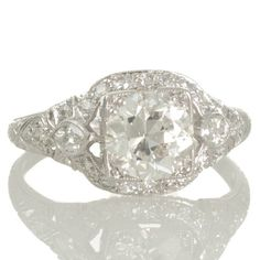 An original Art Deco platinum diamond engagement ring  featuring a 1.41ct transition cut diamond. View our collection of Art Deco and modern diamond engagement rings at www.rutherford.com.au