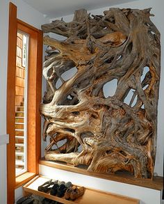 A wall mounted artistic installation made from a rootmass.