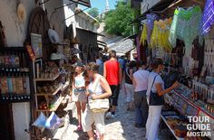 Tourists enjoying souvenirs, handcrafts and paintings on the streets of Old Town in Mostar. #mostar #TGM #TourGuideMostar #souvenirs #europe #handcrafts #architecture #paintings #citylife #tradition #herzegovina