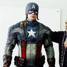 Chris Evans - Captain America. I would apply for that job - Caps wardrobe - Hell Yea!!