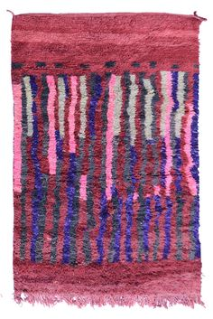 THE COLOR PURPLE boujad berber rug [268x160cm - 8.7x5.2ft] $772.00 Boujad rugs are handwoven from the small city of Boujad on the edge of the Atlas Mountains. These rugs feature hues of orange, red, pink and magenta, with bold lozenge motifs and geometric patterns. Made by Berber women, each piece tells a personal tale depicting fertility, marriage and spiritual beliefs. These beautiful thick wool rugs will suit perfectly any modern interior, on the floor or even hanging on the wall.