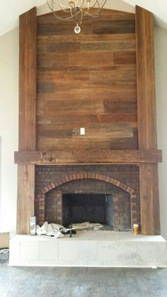 We reworked this big brick fireplace with a hand hewn mantle, big posts and planking. (really like the look of the wood - family room? Rustic Fireplaces, New Homes, Fireplace Remodel, Remodel, Home, Reclaimed Wood Fireplace, Family Room, Family Room Design, Wood Fireplace