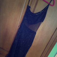 Black 100% Silk one shoulder dress w/ beaded decor This dress also has a see through mid section and slight slit on the bottom. Amazing quality with 100% silk material and beaded decor. Beautiful for any formal occasionGreat quality, good condition Royal feelings Dresses One Shoulder
