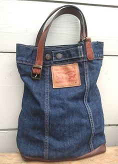 This bag has a history of being a Levis jacket my son wore in a bad car accident, he made it home but his clothes got cut into pieces. A piece of miracle as a bag. Reusing scraps and pieces for the care of our planet Find me on my etsyshop - careforus Blue Jean Purses, Old Jeans, Levis Jeans, Denim Purse, Denim Crafts, Purses And Bags, Levis Jacket, Leather Wallets, Leather Bags