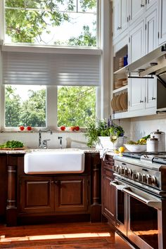 Create a beautiful lighthouse inspired Lake House Kitchen design with Dura Supreme Cabinets - designed by Kim D. Hoegger at Kim Hoegger Home in Rockwell, Texas
