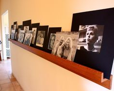 Houzz.com - Shannon Malone.  I LOVE the casual look of this family photo display. The ledge looks to be beautifully constructed of quarter-sawn oak. Wish I had a wall wide enough to do this (and a less dusty house--I'd worry a bit about the photos/prints).