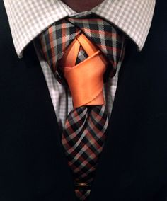 Bringing the orange out of the patterned necktie really makes this thing pop.