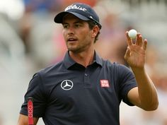 Adam Scott reacts after putting for birdie on the 18th green during ...