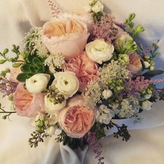 Bride bouquet  Yes it's possible: Find Gorgeous and affordable flowers for your wedding.  www.gmkfloraldesigns.com (610) 220-8764 gmkfloraldesigns@yahoo.com  #weddingflowers #bride #bouquet #flowers #ceremony #reception #floraldesign #gmkfloraldesigns #boutonnière