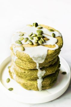 Feeling breakfast adventurous? How about Avocado Pancakes made with oat or almond flour and tons of delicious fluffy sweet flavor despite their funky color!
