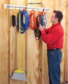Mount a towel bar (or pipes), and then use S hooks to hold cables, etc.  Garage Storage: DIY Tips and Hints - Article | The Family Handyman