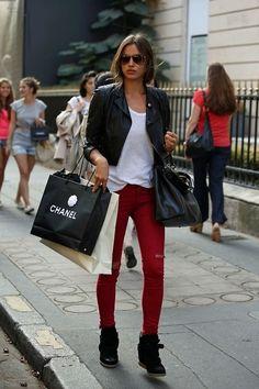 Russian model Irina Shayk in black leather jacket, white tank, Rag & Bone red distressed skinny jeans, black Fendi Peekaboo leather tote, Isabel Marant Bekket sneakers and Gucci sunglasses.