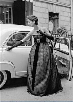 Model wearing an empire waist, point d'esprit evening dress by Christian Dior, 1951.