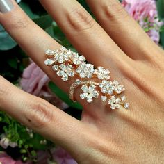 David Morris Cherry Blossom diamond ring. The diamond blossoms stretch from the knuckle to the mid-finger. Discover the top 5 rings gift guide ideas for fashionable and stylish women: http://www.thejewelleryeditor.com/jewellery/top-5/top-5-unique-rings-christmas-gift-guide/ #jewelry