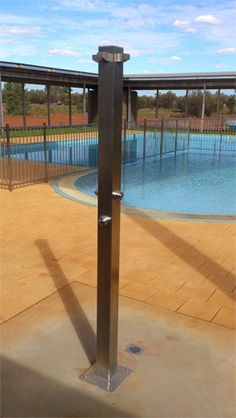 Rainware Commercial Outdoor Shower at public pool in Ayers Rock.  www.rainware.com.au