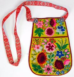 Each Bunad from Norway, and other Scandinavian countries -- have traditional embroidered bags that clip to the waist, or like this one, from Sweden DALA-FLODA IN DARLECARLIA, SWEDEN.