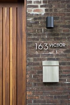 Very stylish house numbering with matching stainless steel mailbox and a spotlight for after dark~