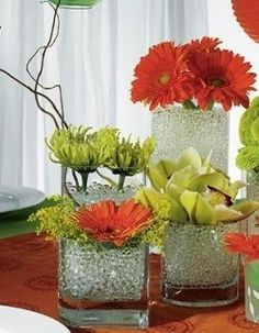 Dining Room Centerpiece. Love the different vases and sizes.
