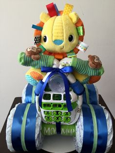 Lion Diaper Bike, Diaper Cakes, Diaper Creations, 4-Wheeler Diaper Cake, Taggies, Baby Shower Centerpieces, Baby Gifts