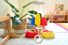 I want to share with you this cute mobile that Otto has been using and absolutely loving. We've used it hanging on the play gym and now over the movement area. The child can bat at or pull on the ring to make the wooden bells (or chimes) ring. Montessori Baby, Maria Montessori, Godly Play, Play Gym, New Mobile, Sewing For Kids, Kids House, Early Childhood, Craft Projects