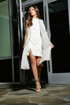 White high neck mini dress with longline vest