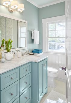 Bright Ideas for a Colorful Whole House Remodel A shared bath on the second floor mingles a traditional beadboard wainscot and a paneled door with polished finishes like a marble-topped vanity bathroom bathroomideas bathroomvanity Coastal Bathrooms, Beach Bathrooms, Modern Bathroom, Master Bathroom, Vanity Bathroom, Neutral Bathroom, Blue Bathrooms, Relaxing Bathroom, Dyi Bathroom