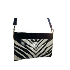 "Kate Spade Crossbody/Clutch Beautiful Kate Spade Crossbody/clutch. Patent leather. Black and white Zebra striped. Two interior pockets, one zips, one doesn't. Gold Spade emblem inside! Three light scuff marks that aren't noticeable. Strap is 48 inches and removable ( PB2)""SALE DOES NOT APPLY"" kate spade Bags Crossbody Bags"
