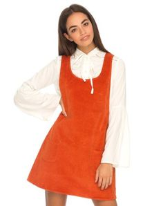 Check out this cutey! We are totally working the preppy vibes this season in this sweet corduroy pinafore dress. With a round scoop neck line, a line fit and two small front pocket. This bold copper coloured dress is perfect layered up with a retro blouse and ankle boots