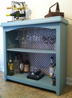 Finally finished my bar made from a bookshelf, just added the last wine glass rack. So cute & so easy to do!!!!!!
