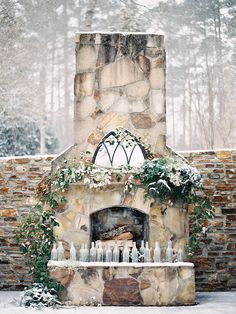 Stone fireplace turned winter #ceremony altar | Photography: Laura Leslie Photography - www.lauralesliephotography.com Photography: Gracie Blue Photography - www.grblue.com  Read More: http://www.stylemepretty.com/2014/04/24/enchanted-winter-wedding-inspiration/