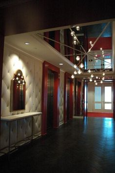 TVSdesign (Atlanta) uses a BRADLEY  'Wendy' Mirror, 'Beth' Console Table, and antique mirror ceiling panels in the elevator lobby at the SPANX headquarters in Atlanta.  www.BRADLEY-USA.com