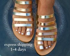 Browse unique items from Leatheropolis on Etsy, a global marketplace of handmade, vintage and creative goods. Toe Ring Sandals, Gold Sandals, Toe Rings, Strappy Sandals, Leather Sandals, Gladiator Sandals, Metallic Sandals, Metallic Gold, Silver