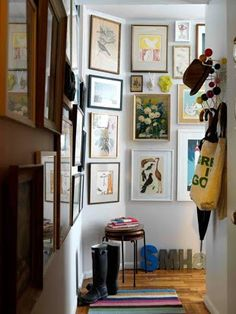 Sweet and rustic gallery wall in a cramped, small house main entry http://fengshui.about.com/od/faq/f/good-feng-shui-main-entry.htm It actually brings it to life! But it can also look cluttered, so it is all about keeping the right balance between charm and clutter. More tips: http://FengShui.About.com