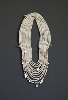 beaded t-shirt yarn necklace - love this kind of design in silver (of course)