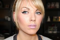 cat eye with liner, pink lips