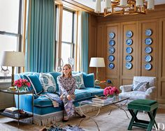Tory Burch perches on a cotton-velvet sofa in her office's sitting area / Living Room.