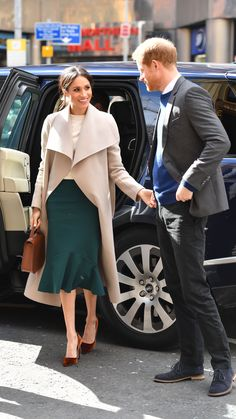 23 March 2018 - Harry and Meghan visit Belfast, Northern Ireland - coat by  Mackage, sweater by Victoria Beckham, shoes by Jimmy Choo