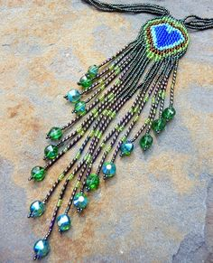 Sparkalicious  - Beadwoven Peacock Feather Tassel Choker. $125.00, via Etsy.