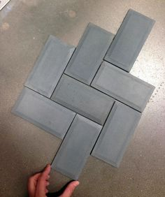 Lowes concrete tile   about $7 a square foot and it comes unsealed.