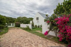 Situated in a quiet suburb, adjacent to the natural dune forests of Port Alfred, this cluster home offers peace and tranquility. Comprised of open plan. Kitchen Views, Water Heating, Bedroom With Ensuite, Timber Flooring, Good House, Water Supply, Open Plan Living, Lofts, Windows And Doors