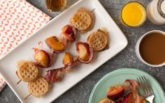 Fruit and Waffle Kabobs // Serve these tasty skewers, threaded with peaches, plums, crisp bacon and mini waffles, on a bed of fluffy scrambled eggs for a breakfast or brunch that's unique and fun. Serve with more maple syrup on the side, if you like.