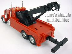 The LongHauler series by NewRay are models at 1/32 scale. These utility trucks are different from the cab-only models since the will be a little bit longer, depending on the particular model They meas