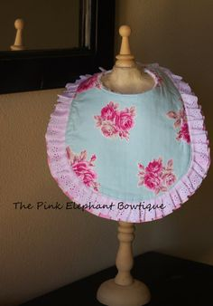 Become a fan on Facebook and receive 15% off your first order! Message me & I will send you the coupon code to use at checkout, its that easy!  http://www.facebook.com/thepinkelephantbowtique    Perfect for any little girl... fits ages newborn - Toddler. Made with 3 layers: designer fabric, absorbent liner, and a super soft chenille back layer to protect babys sensitive skin (& adorable clothes!). Made with a snap closure, so you dont have to worry about it falling off if your little one…