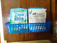 A small dollar store basket mounted inside a kitchen cupboard door can be a great place to hold spice packets {featured on Home Storage Solutions 101}