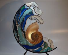 """Nautilus,"" stained glass, Nautilus shell, iron stand, by artist Christine Stracener"