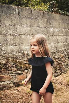 Gorgeous black sunsuit. #designer #kids #fashion