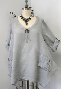 Simply elegant Ramie Linen Over sized tunic top is a must have to stay cool in Summer. It is made over sized for fun and enjoy the heat of the summer as Linen being natural fiber keep the body cool. The buttoned up long sleeve tunic is versatile for sporty and smart look. Being over sized will cover 3 sizes in one. Read the bust measurements below  ***Elegant Design*** ***Smart roll up full Sleeves for all year wear*** ***Designer two front Pockets**** *** Sweep****  ****** OVERSIZE LINEN…